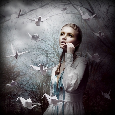 19002247-inspiration-woman-with-flying-white-origami-swans-in-dark-mystic-forest